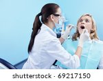 The dentist examines a patient - stock photo