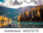 xinjiang kanas river scenery   Shutterstock . vector #692172775