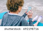 back view of unrecognizable... | Shutterstock . vector #692198716