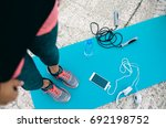 top view of woman on yoga mat... | Shutterstock . vector #692198752