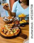 overweight woman eating junk...   Shutterstock . vector #692200708