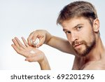 man with a beard on white... | Shutterstock . vector #692201296