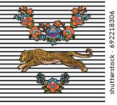 leopard with flowers. vector...   Shutterstock .eps vector #692218306