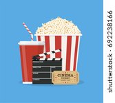 clapperboard and popcorn and... | Shutterstock .eps vector #692238166