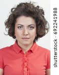 Stock photo passport image of a curly woman with expressive eyes 692241988
