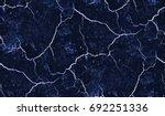 dark blue background worn denim ... | Shutterstock . vector #692251336