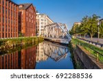 gray metal bridge over canal... | Shutterstock . vector #692288536