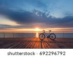 silhouette of a bicycle on the... | Shutterstock . vector #692296792