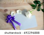 white rose with gift card | Shutterstock . vector #692296888