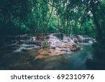 huai mae khamin waterfall... | Shutterstock . vector #692310976