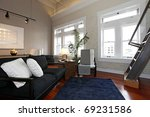 Modern large living room with brick walls and modern furniture. - stock photo