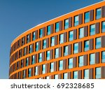 orange curved office building... | Shutterstock . vector #692328685
