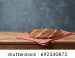 wooden tray with checked... | Shutterstock . vector #692330872