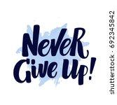 hand written never give up... | Shutterstock .eps vector #692345842