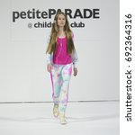 Small photo of New York, NY USA - August 6, 2017: Young model walks runway for MOD Activewear during petiteParade at children's Club August 2017 edition at Jacob Javits Center