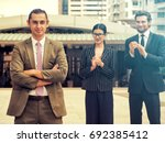 successful businessman at the... | Shutterstock . vector #692385412