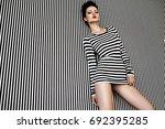 fashion woman in striped dress... | Shutterstock . vector #692395285
