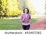portrait of elderly woman... | Shutterstock . vector #692407282