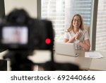 smiling businesswoman talking... | Shutterstock . vector #692440666