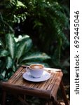 a cup of coffee on the table ... | Shutterstock . vector #692445046