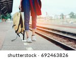 a walking young girl tourist on ...   Shutterstock . vector #692463826