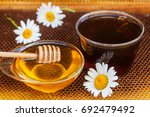 glass cup tea with honey  wood... | Shutterstock . vector #692479492