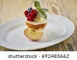 dessert on a beautiful wooden...   Shutterstock . vector #692483662