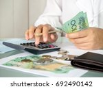accountant woman counting an... | Shutterstock . vector #692490142