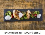 beautiful and tasty food on a... | Shutterstock . vector #692491852