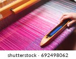 Close Up Hands Of Woman Weavin...