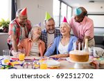 cheerful friends looking at... | Shutterstock . vector #692512702