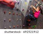little girl in a pink t shirt... | Shutterstock . vector #692521912