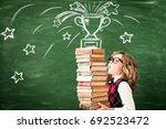 portrait of child in classroom... | Shutterstock . vector #692523472