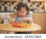 baby girl eating messy... | Shutterstock . vector #692527885