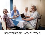 smiling seniors sitting with... | Shutterstock . vector #692529976