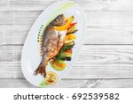 grilled dorado fish with baked... | Shutterstock . vector #692539582