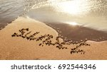 the wave washes the inscription ... | Shutterstock . vector #692544346
