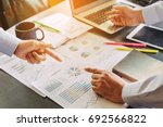 two businessman investment... | Shutterstock . vector #692566822