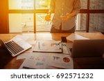 young businessmen hand holding... | Shutterstock . vector #692571232