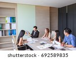business people discussing... | Shutterstock . vector #692589835