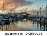 sunset in auckland harbour | Shutterstock . vector #692590285