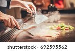 hand of man take cooking of... | Shutterstock . vector #692595562