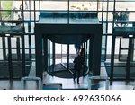 revolving door in reception of... | Shutterstock . vector #692635066
