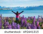 woman traveller at lake tekapo  ... | Shutterstock . vector #692641315