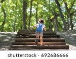 Little Girl Climbing The Stair...