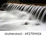 nice cascade of small waterfall ... | Shutterstock . vector #692704426