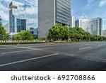 empty asphalt road through... | Shutterstock . vector #692708866