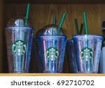 Small photo of KUALA LUMPUR, MALAYSIA - AUGUST 05, 2017 : Starbucks drinkware. Starbucks branded and logo cold cups at store.