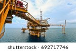 offshore oil rig in the middle... | Shutterstock . vector #692717746
