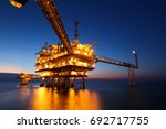 offshore oil rig in the middle... | Shutterstock . vector #692717755